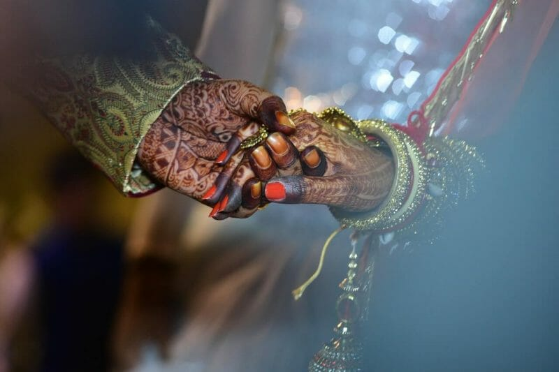 groom holding bride hand