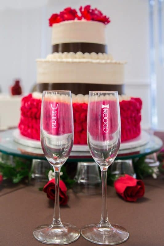 3 layer anniversary cake with champagne glass